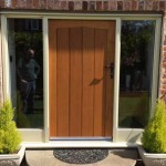 Light brown timber entrance door