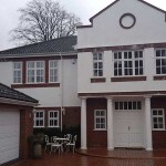 White casement windows and double entrance doors
