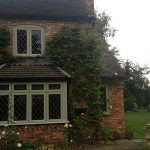 Green timber bay windows
