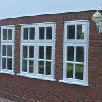 Storm proof white timber windows