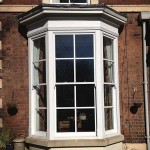Timber sash white bay windows