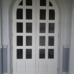 White arched interior door